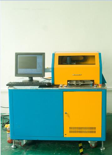 展耀激光ZYAO-200K自动进料、自动开槽、自动调整开槽机